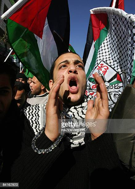 Palestinian university students mostly Fatah supporters join a demonstration against the weeklong Israeli bombardment of the Gaza Strip in the West...