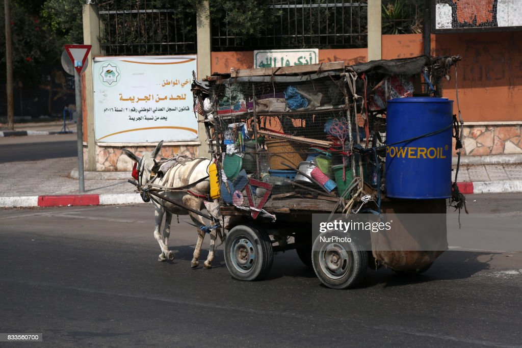 A Palestinian vendor on a donkey dragged cart was seen in Gaza city selling second-hand household utensils in Gaza City, Aug. 17, 2017.
