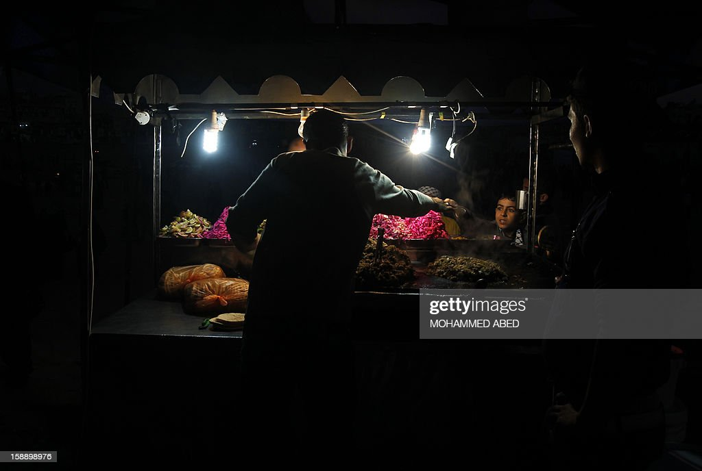 A Palestinian vendor sells fast food on a street in Gaza city on January 2, 2013. The Gaza branch of Palestinian president Mahmud Abbas's Fatah party has started celebrations of its 48th anniversary in the Hamas-ruled territory, a local leader said.
