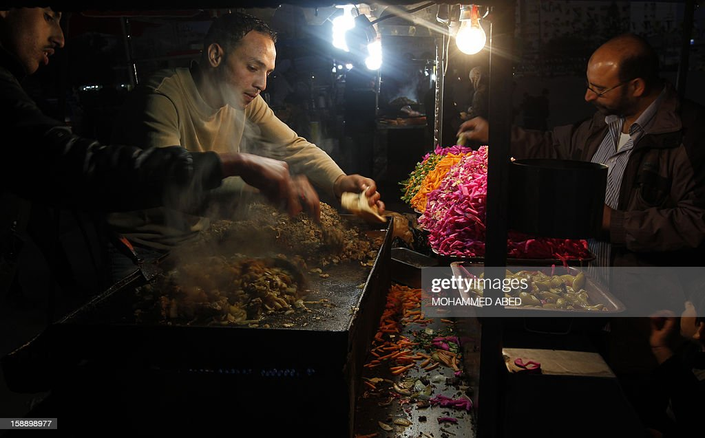 A Palestinian vendor sells fast food on a street in Gaza city on January 2, 2013. The Gaza branch of Palestinian president Mahmud Abbas's Fatah party has started celebrations of its 48th anniversary in the Hamas-ruled territory, a local leader said. AFP PHOTO/MOHAMMED ABED