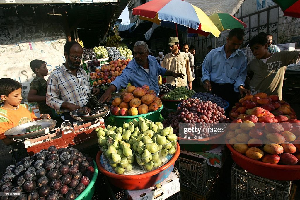 Palestinian vendors sell fruit in the Zawea market August 23 2007 in Gaza City Gaza Strip