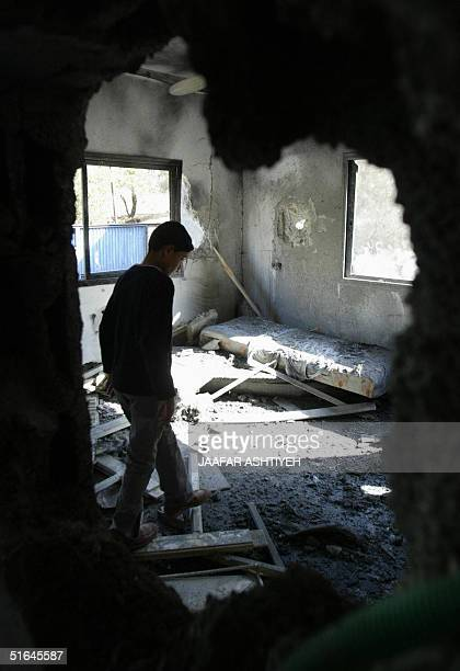 Palestinian walks amid the wreckage of the family house of 16yearold Amer AlFar the suicide bomber who blew himself up and killed three other people...