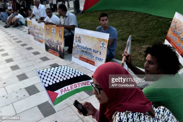 Palestinian who live in Greece demonstrate against the Israeli police ban on Muslim men under the age of 50 from alAqsa mosque in Jerusalem in...