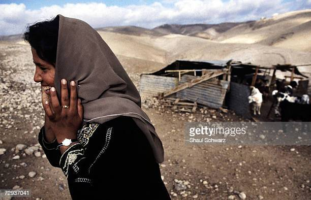 Palestinian woman belonging to the Jihalin tribe in Kfar Edumin near Maale Edumim stands near her tent The village contains 30 members of the same...