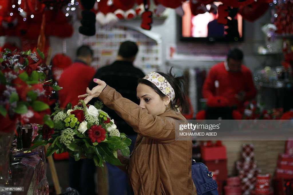 A Palestinian woman buys flowers on Valentine's Day in Gaza City on February 14, 2013. Valentine's Day is increasingly popular in the region as people have taken up the custom of giving flowers, cards, chocolates and gifts to sweethearts to celebrate the occasion.