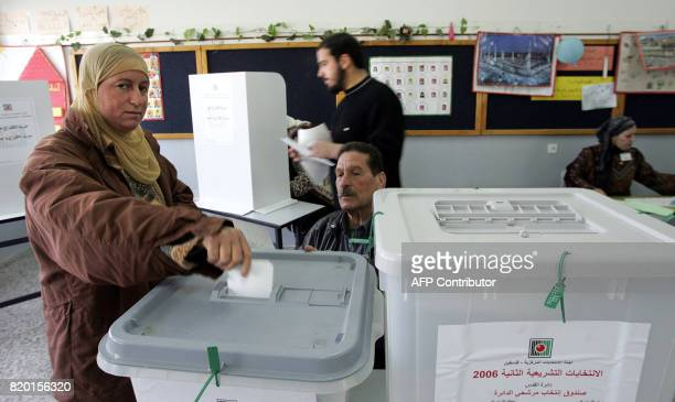 A Palestinian woman casts her ballot for the Palestinian elections at a polling station in Sheikh Saad a district of East Jerusalem 25 January 2006...