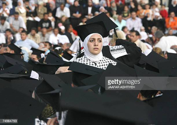Palestinian woman dressed in a cap and gown in the black and white colours of the Kefiyeh the traditional Palestinian head dress and trademark of the...