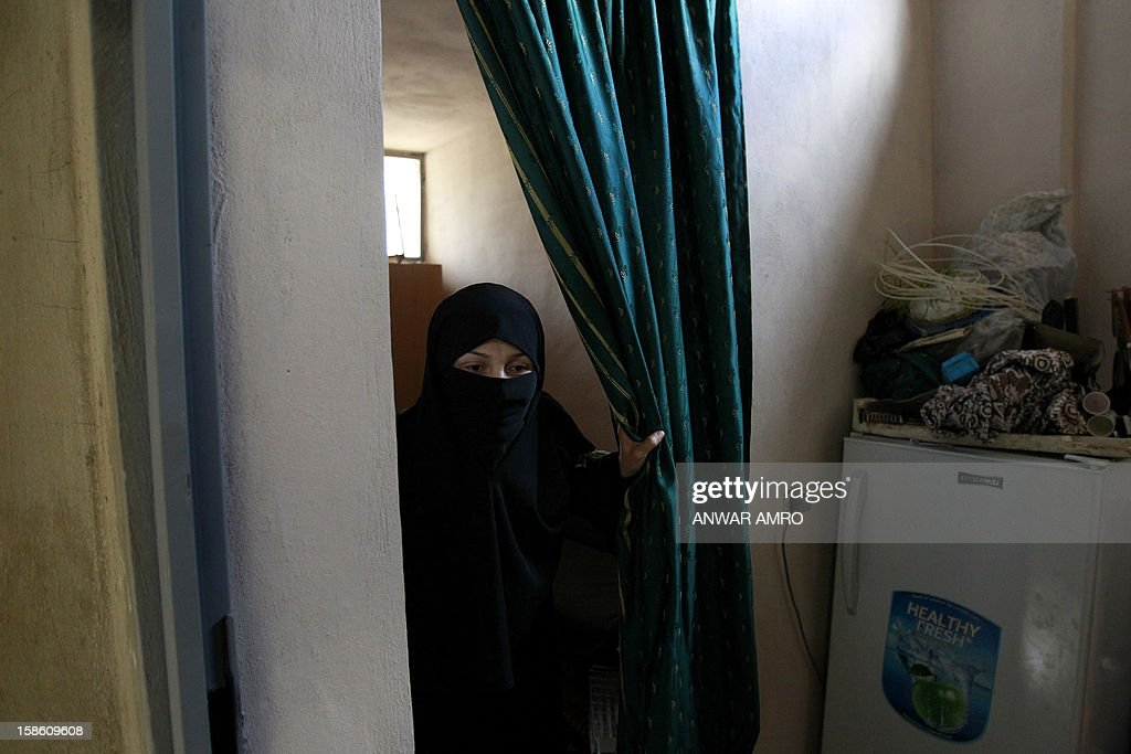 Palestinian woman from the Syrian refugee camp of Yarmuk stands in her temporary home at the Shatila refugee camp in the Lebanese capital Beirut on December 19, 2012. Some 13,000 members of Syria's Palestinian refugee community have gone back to square one in neighbouring Lebanon. Like their ancestors, they too have been forced to flee their birthplace into exile.