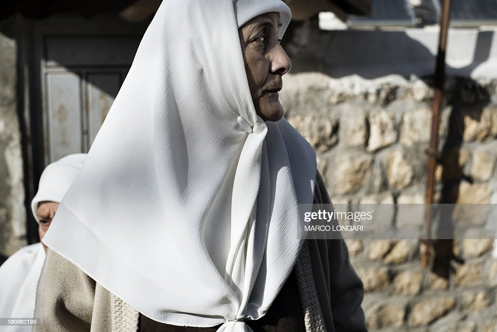 A Palestinian woman of the Shamasneh family takes part in a demonstration in the mostly Arab neighbourhood of Sheikh Jarrah in east Jerusalem on February 8, 2013 to protest against an eviction order imposed by an Israeli court that will see the family leaving their home which will be given to a Jewish organisation.