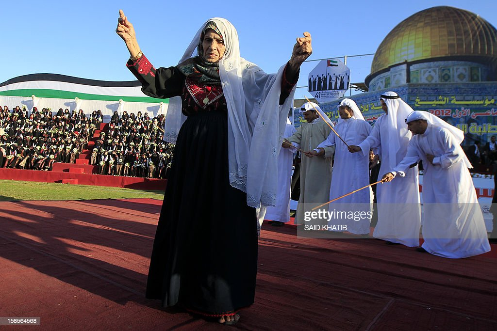 A Palestinian woman performs a dance during a mass wedding ceremony in Rafah, southern Gaza Strip, on December 19, 2012. Some 436 couples in need participated to the mass wedding organized by the National Islamic Committee in the Gaza Strip and other financial donations. AFP PHOTO / SAID KHATIB