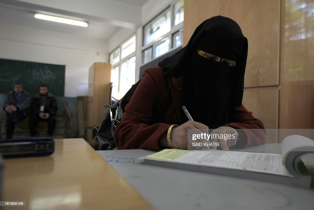 A Palestinian woman registers at a registration office in Rafah town in the southern Gaza Strip on February 18, 2013. Palestinian electoral officials extended for two additional days the process of updating voter rolls in the West Bank and Gaza After a week of beginning registration in a vital step towards eventual elections.