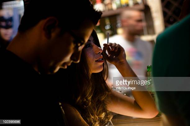Palestinian woman smokes a cigarette at the bar in the Orjuwan Lounge on June 24 in Ramallah West Bank Nightlife in Ramallah is on the rise as...