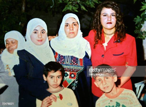 Palestinian woman suicide bomber Wafa Idris poses with unidentified relatives in this undated family photograph in the Amari refugee camp in the West...