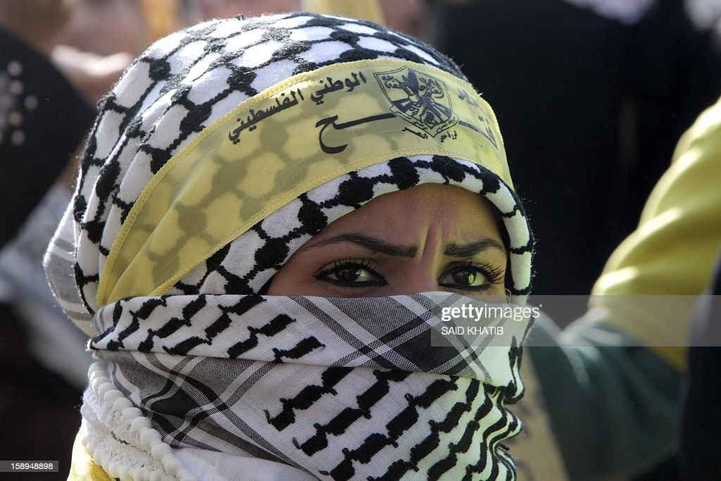 A Palestinian woman supporter of Palestinian president Mahmud Abbas's wears a scarf and a Fatah headband as she takes part on January 4, 2013 in Fatah's first mass rally in Gaza since Hamas seized control of the territory in 2007. Hamas, in a sign of reconciliation with Fatah, permitted the rally to go ahead as the climax of a week of Gaza festivities celebrating the 48th anniversary of Fatah taking up arms against Israel. AFP PHOTO / SAID KHATIB
