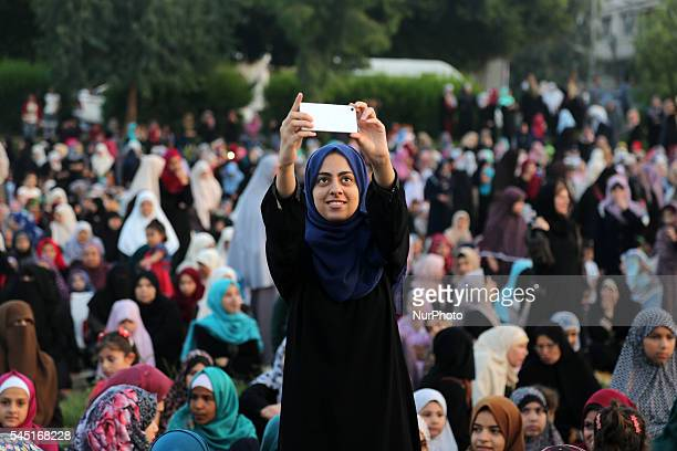 A Palestinian woman takes a selfie during the morning prayers for Eid alFitr celebrations which marks the end of the holy fasting month of Ramadan in...
