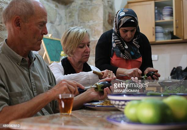 Palestinian woman teaches foreigners to cook traditional Palestinian dishes in the West Bank city of Nablus on September 19 2015 More than 1200...