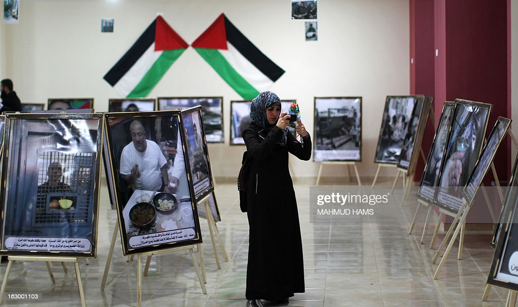 A Palestinian woman visits a photography exhibition showcasing the life of Palestinian prisoners in Israeli jails in Gaza City on March 3, 2013. The exhibition presents a collection of leaked pictures showing Palestinian prisoners held in Israel. The death last week of Palestinian inmate Arafat Jaradat, 30, triggered several days of clashes between Palestinian demonstrators and Israeli soldiers in the West Bank that left dozens of Palestinians wounded.