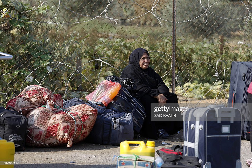 A Palestinian woman waits to cross from the Gaza Strip to Egypt at the Rafah crossing terminal on November 19, 2013. Hundreds of patients, students and foreign residents from the Palestinian side have rushed to the Rafah crossing after the Egyptian announcement of re-opening it for 3 days. AFP PHOTO / SAID KHATIB