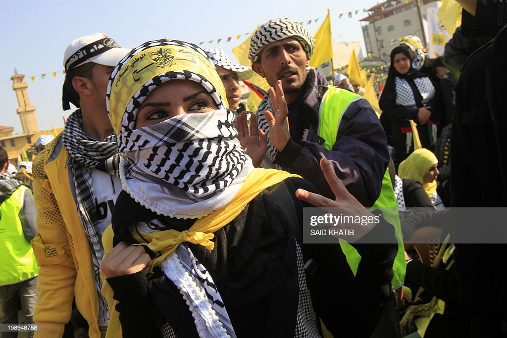 A Palestinian woman, wearing a scarf and a Fatah headband takes part on January 4, 2013 in Fatah's first mass rally in Gaza since Hamas seized control of the territory in 2007. Hamas, in a sign of reconciliation with Fatah, permitted the rally to go ahead as the climax of a week of Gaza festivities celebrating the 48th anniversary of Fatah taking up arms against Israel. AFP PHOTO / SAID KHATIB
