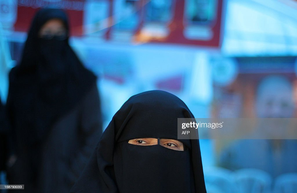 A Palestinian woman, wearing the niqab, participates in the sit-in demonstration in support of Palestinian prisoners held in Israeli jails, some of whom are observing a hunger strike, in a tent outside the headquarters of the Red Cross in Gaza City on December 29, 2012.