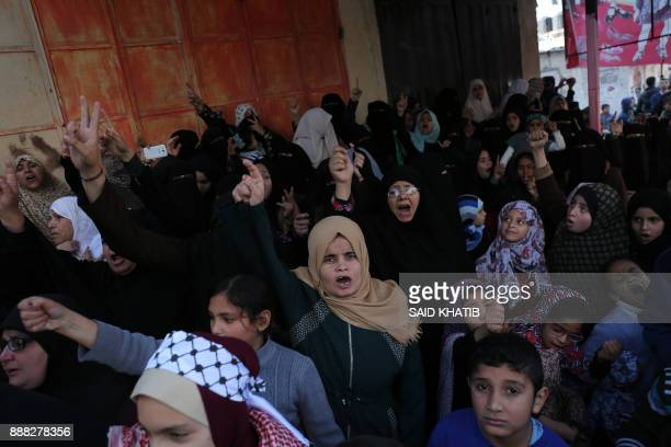 Palestinian women and children join a protest in the southern Gaza Strip town of Rafah on December 8 2017 against US President Donald Trump's latest...