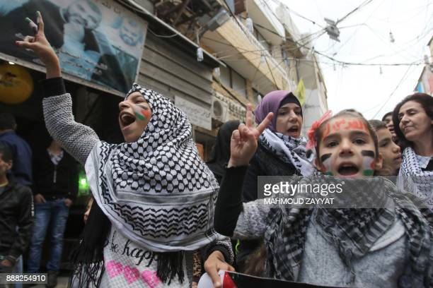 Palestinian women and children take part in a protest in the refugee camp of Ain elHelwe on the outskirts of the southern Lebanese port city of Sidon...