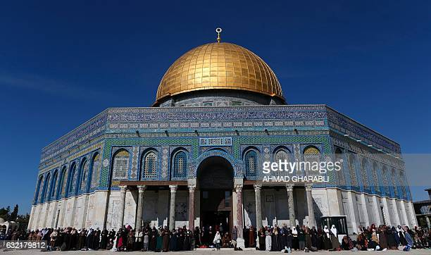 Palestinian women attend Friday prayers in front of the Dome of Rock at the AlAqsa Mosque compound in Jerusalem's Old City on January 20 2017 / AFP /...