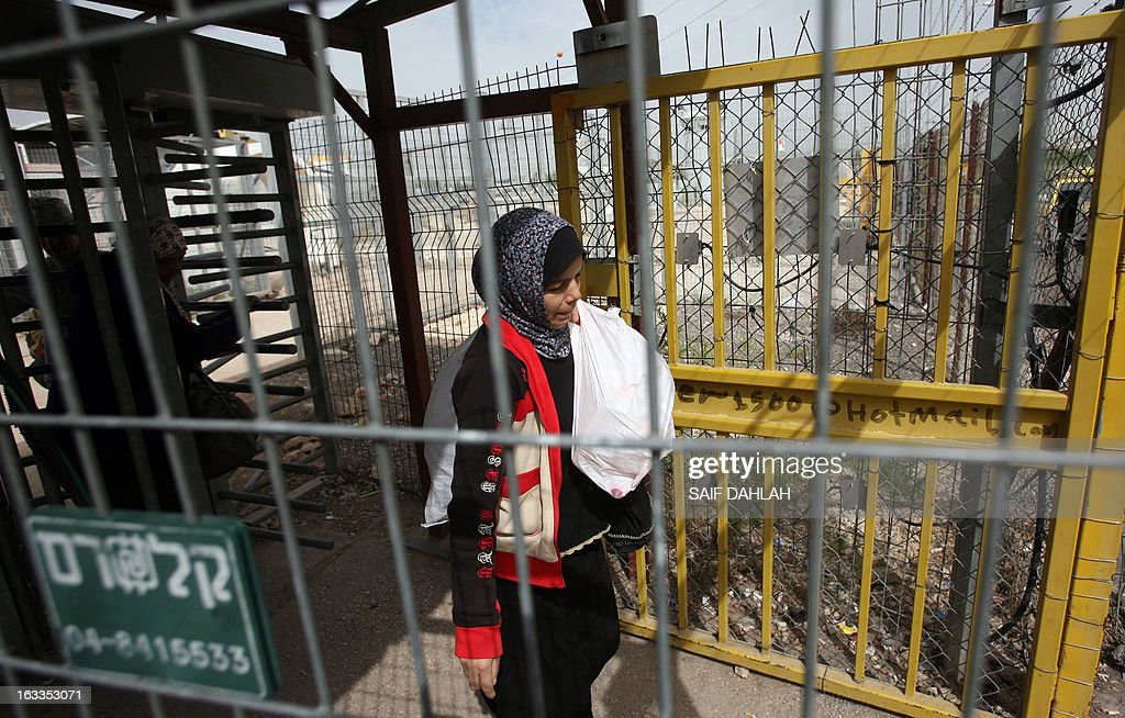 Palestinian women cross the Israeli Jalama checkpoint, near Jenin, as they return home to the West Bank after spending the day working in Israel on March 8, 2013, which marks International Women's Day across the globe.