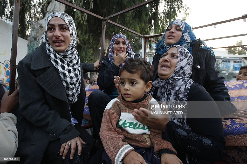 Palestinian women cry after they evacuated their homes to take shelter at a United Nations (UN) school in Gaza City on November 20, 2012. A group of 38 aid agencies urged the international community to take action to secure a ceasefire in Gaza to prevent 'another widespread humanitarian disaster.'
