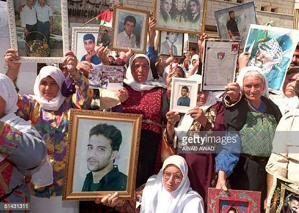 Palestinian women demonstrate 14 October 1993 for the liberation from Israeli jails of their sons husbands and fathers Israel and the PLO during...