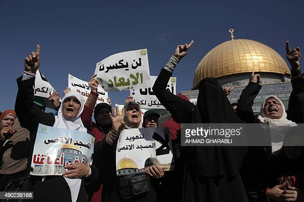 Palestinian women demonstrate in front of the Dome of the Rock after clashes between Palestinian stone throwers and Israeli forces at Jerusalem's...