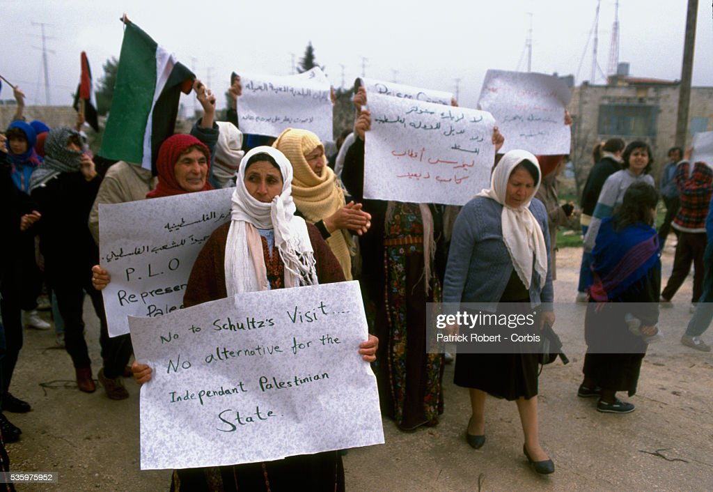 Palestinian women demonstrators carry signs during a protest in Ramallah. Violence broke out after rebel Israeli and Palestinian fighters protested in the disputed territory of West Bank during the first Intifada.