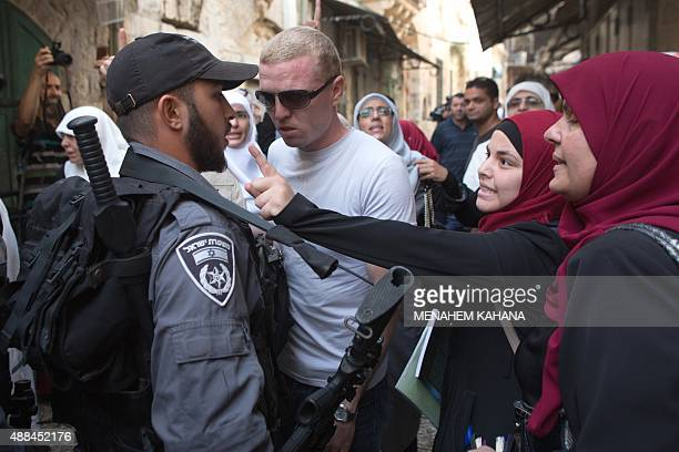 Palestinian women from the socalled Murabitat group argue with Israeli policemen during a protest against Jewish groups visiting the AlAqsa mosques...