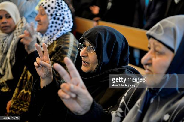 Palestinian women gesture during a demonstration in support of her relatives held in Israeli prisons in front of the International Red Cross and Red...