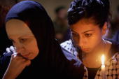 Palestinian women hold a candlelight vigil outside President Yasser Arafat's Muqataa headquarters on November 10 Ramallah West Bank In the event of...