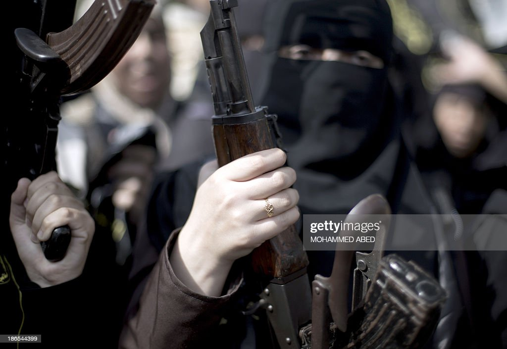Palestinian women hold assult rifles as they take part in a rally by the Islamic Jihad to mark the anniversary of the movement's foundation in Gaza City, on November 1, 2013.