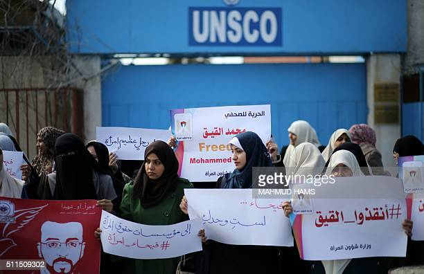 Palestinian women hold posters bearing a portrait of Palestinian hunger striking Palestinian journalist Mohammed alQiq who is imprisoned in an...