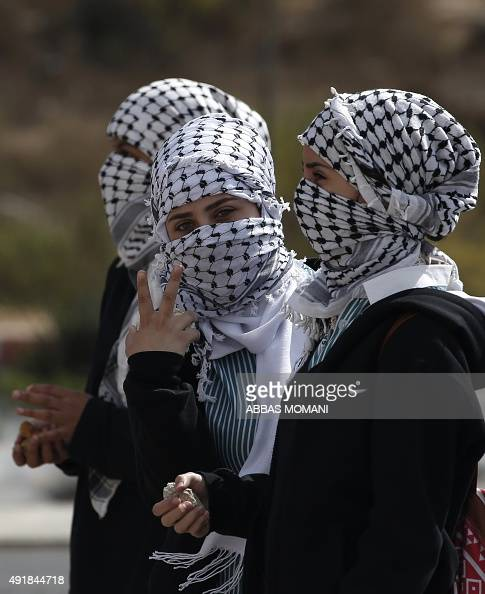 Palestinian women hold stones during clashes with Israeli security forces in Beit El Jewish settlement north of Ramallah in the occupied West Bank on...