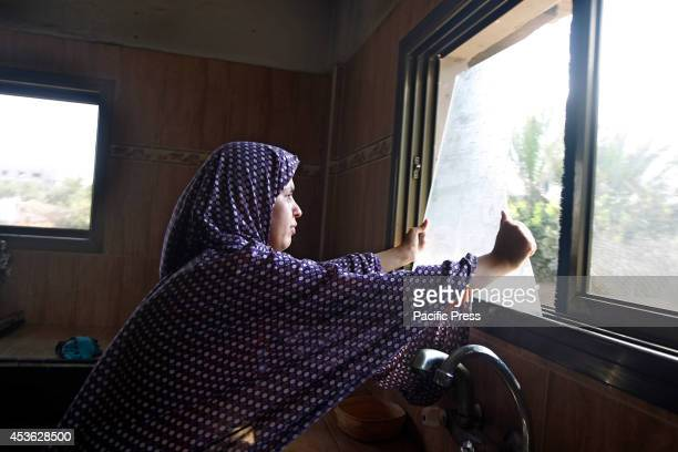 Palestinian women inspects the damage of an Israeli air strike in her home at Khan Younis in the Southern of Gaza City According to the Palestinians...