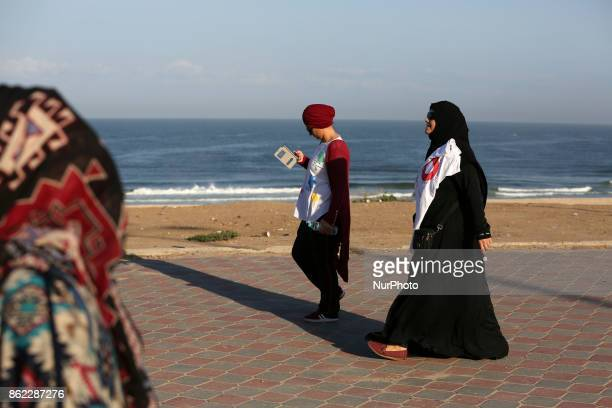 Palestinian women march on a street demonstration and carrying signs reading in Arabic ''Upright walk'' ''restore your youth by walking'' and ''Let's...