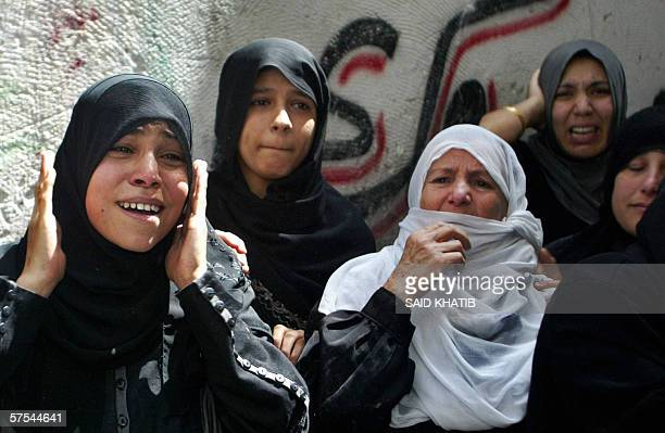 Palestinian women mourn during the funeral of five militants killed yesterday in Gaza City 06 May 2006 Five Palestinians were killed 05 May when an...
