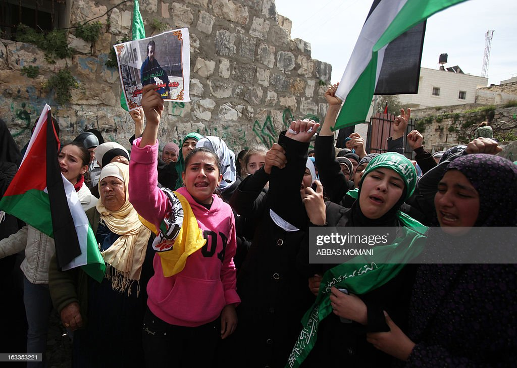 Palestinian women mourn the death of Mohammad Asfour during his funeral in the West Bank village of Abud on March 8, 2013. Asfour, a 22-year-old student studying sports, died of his wounds on March 7 as he was wounded in the head by a rubber-coated steel bullet fired by Israeli troops during a protest which erupted after a prisoner died in Israeli custody.
