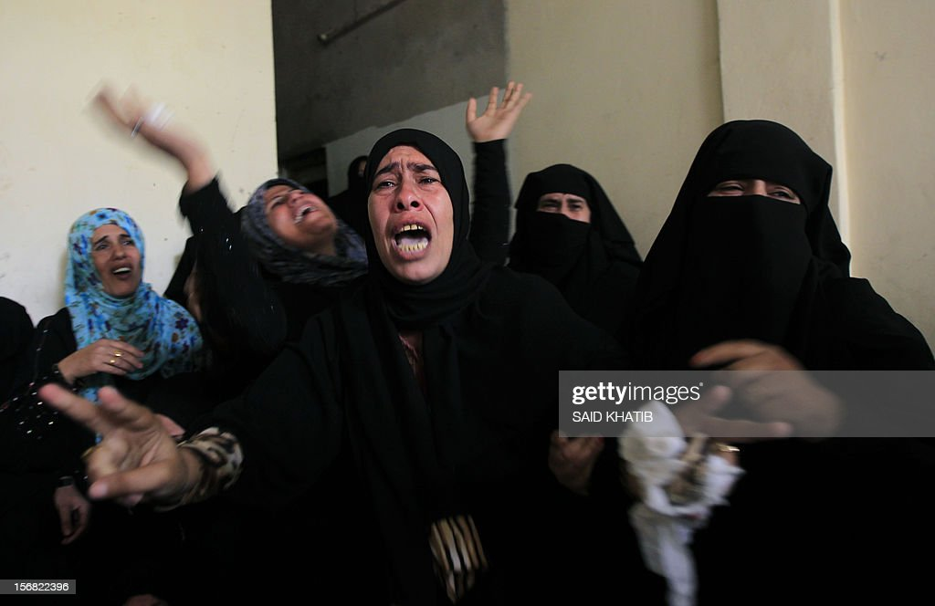 Palestinian women mourn the death of their relative Amira Abu Tair, 17, during her funeral in the southern Gaza Strip town of Khan Yunis on November 22, 2012, after she was killed with her grandfather in an Israeli air strike the previous day. An Egypt-brokered truce took hold in the Gaza Strip, ending eight-day operation during which the Israeli army said it hit more than 1,500 targets, as Gaza militants fired 1,354 rockets over the border.