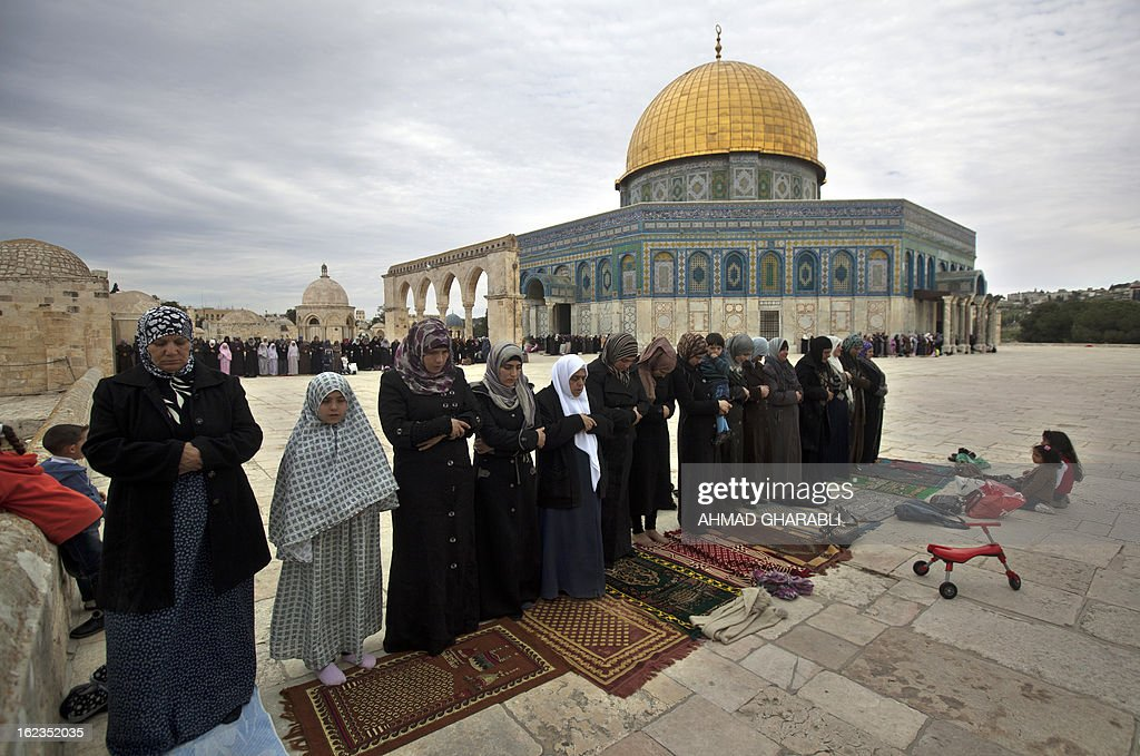 Palestinian women perform Friday prayers outside Jerusalem's Al-Aqsa mosque, following protests in solidarity with hunger-striking Palestinian prisoners on February 22, 2013. Palestinians demanding the release of hunger-striking prisoners clashed with Israelis in the West Bank and east Jerusalem, as three fasting inmates were taken to hospitals. AFP PHOTO/AHMAD GHARABLI