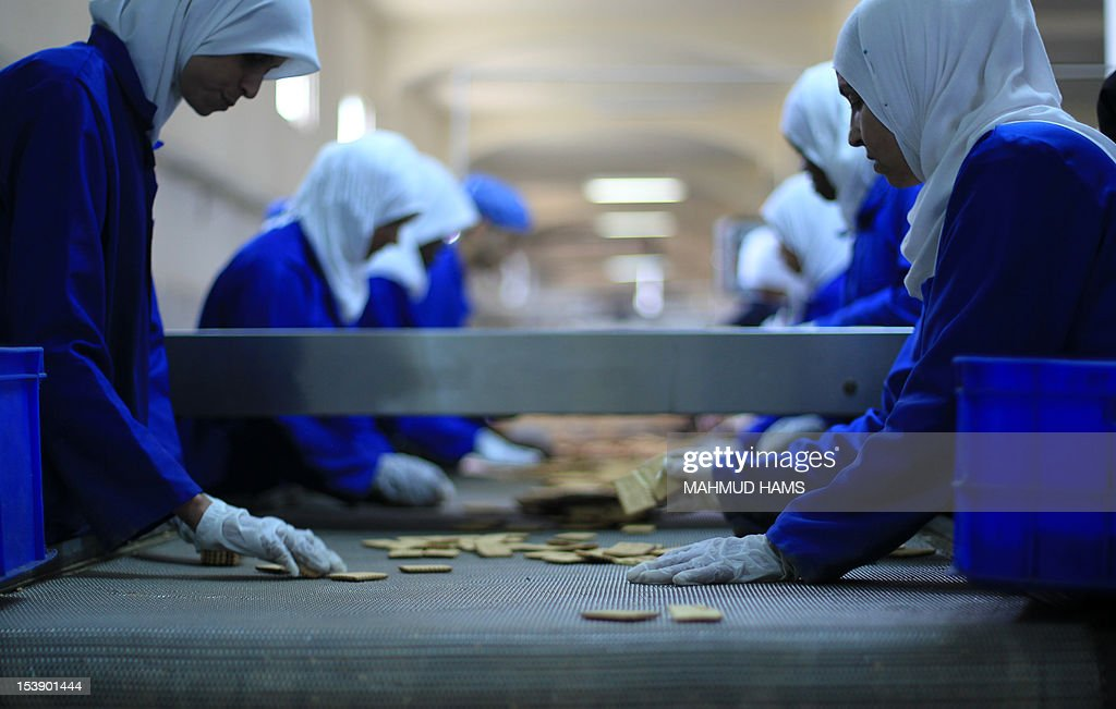 Palestinian women quality control check biscuits at the al-Awda factory in Deir al-Balah, in the central Gaza strip, on October 10, 2012. The World Food Program (WFP) will export the biscuits to United Nation run schools in the Israeli occupied Palestinian West Bank, the first time since 2006 when the Gaza Strip was put under an Israeli blockade.