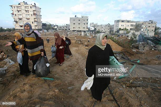 Palestinian women retruns to their house in Beit Lahia northern Gaza Strip on January 18 2009 A nervous peace reigned in Gaza early Sunday amid...