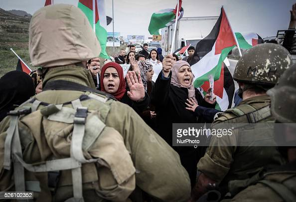 Palestinian women take part in a demonstration to mark the international woman day at Hawara Israeli checkpoint near Nablus city in the West Bank on...