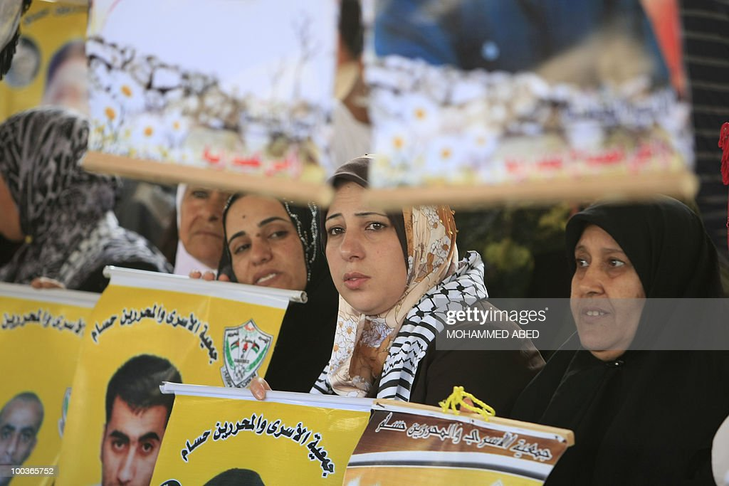 Palestinian women take part in a protest in Gaza City on May 24, 2010 to demand the release of Palestinian prisoners held in Israeli jails. An Israeli ministerial committee approved on May 23 a draft bill seeking to toughen the conditions under which Hamas prisoners are held in response to the stalemate over kidnapped soldier Gilad Shalit.