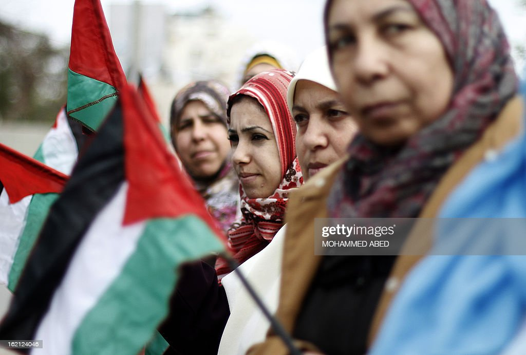 Palestinian women take part in a protest in solidarity with Palestinian prisoners held in Israeli jails in Gaza City on February 19, 2013. Some 800 Palestinians serving time in Israeli jails were refusing food in solidarity with four fellow inmates who have been on long-term hunger strike, officials said. AFP PHOTO/MOHAMMED ABED