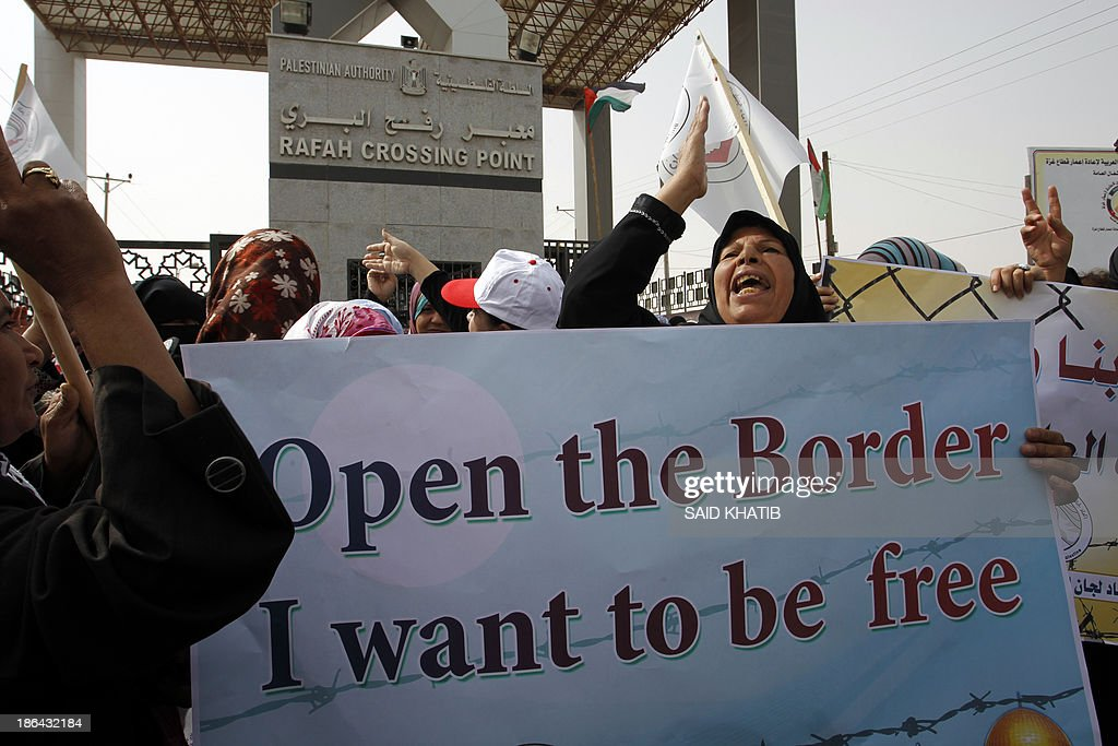 Palestinian women take part in a rally in front of the Rafah border crossing with Egypt in the southern Gaza Strip on October 31, 2013, demanding the permament and unconditional opening of the crossing. Egypt occasionally permits people to enter and leave Gaza, but has refused to open on a permanent basis the only border crossing in the Hamas-run Palestinian coastal strip not controlled by Israel. AFP PHOTO/SAID KHATIB